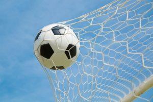 Football Hitting Goal Net