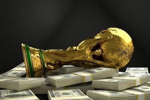 Football World Cup Trophy and Pile of Cash