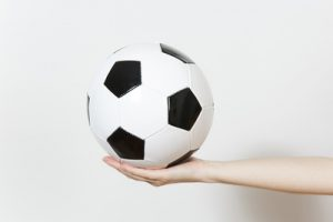 Woman Holding Out a Football