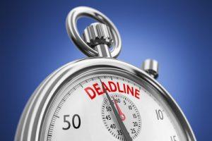 Stop Clock with Deadline Written on Face