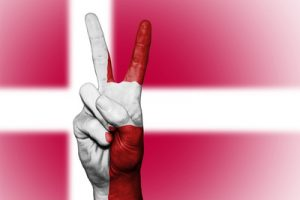 Danish Flag With Hand making Peace Sign