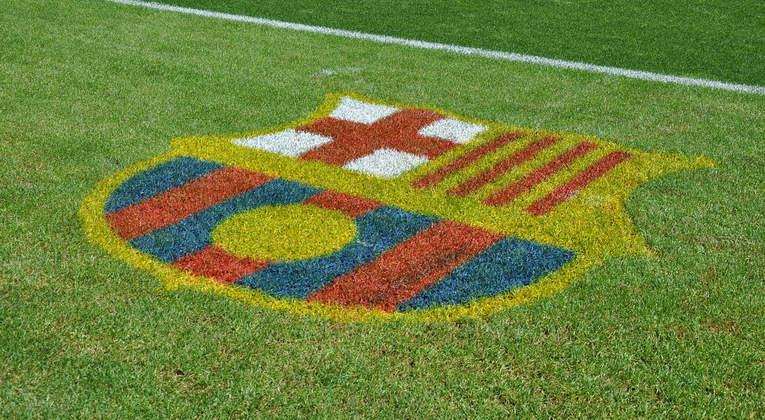 FC Barcelona Logo on Football Pitch