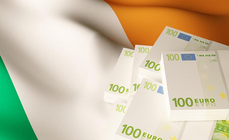 Ireland Flag and 100 Euro Banknotes