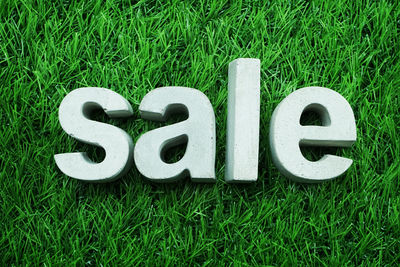 Sale Sign on Grass
