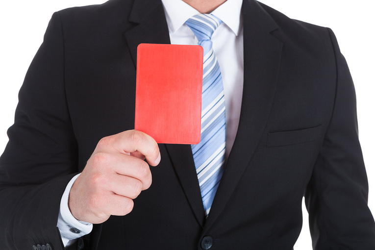 Man in Dark Suit Holding Red Card