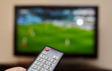 Television Showing Blurred Football