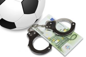 Football with Handcuffs and Euro Banknotes