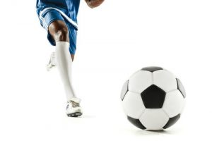 Footballer in Blue Kit Approaching Ball