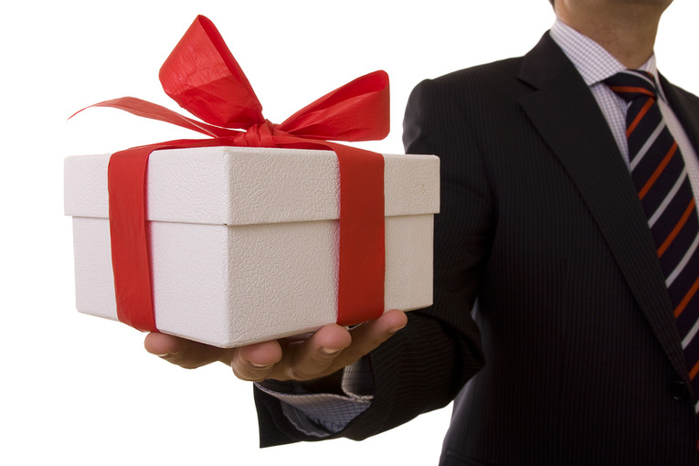 Gift Offered by Man in Suit