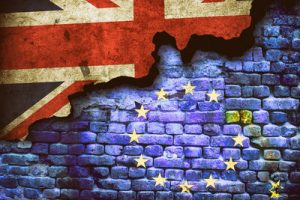 EU and UK Flags on Wall Depicting Brexit