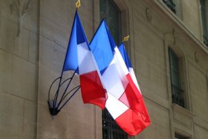 Three French Flags on Building