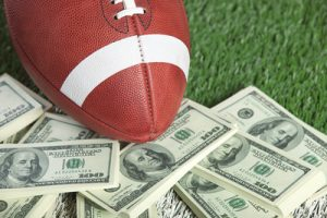 American Football and Dollar Bills