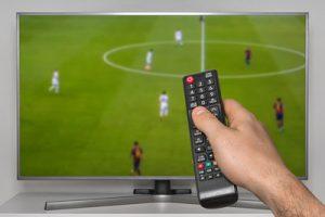 Football Match on TV Screen