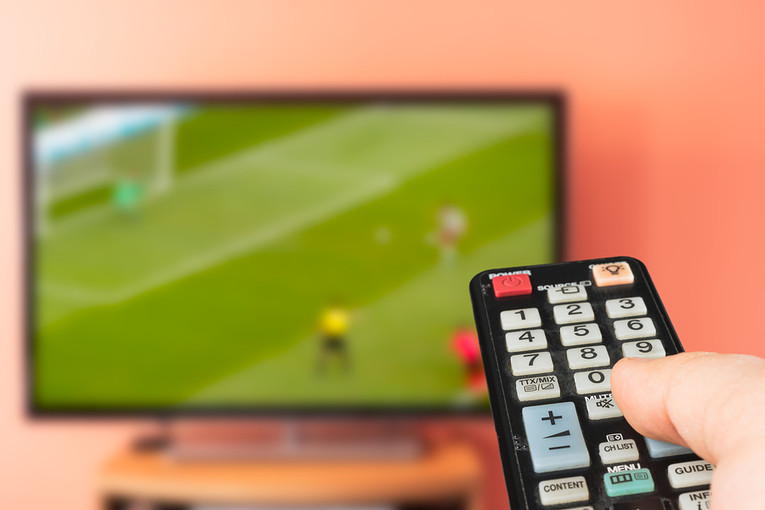 Football on Television Screen
