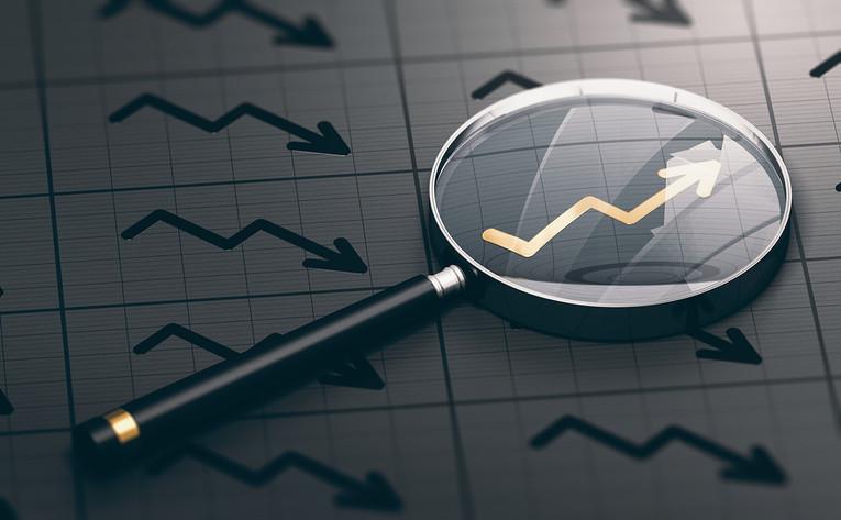 Magnifying Glass Over Upward Chart Arrow
