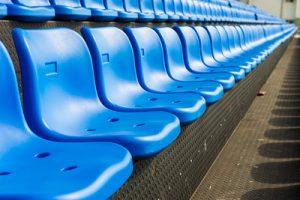 Empty Row of Blue Stadium Seats