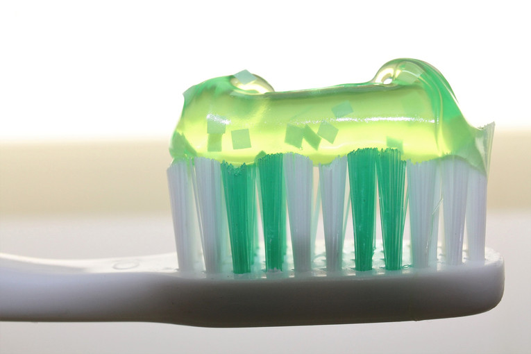 Toothbrush and Green Toothpaste