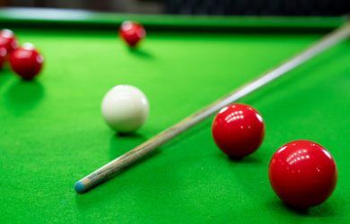 Snooker Cue Laying on Table
