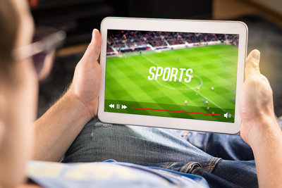 Man Watching Football on Tablet