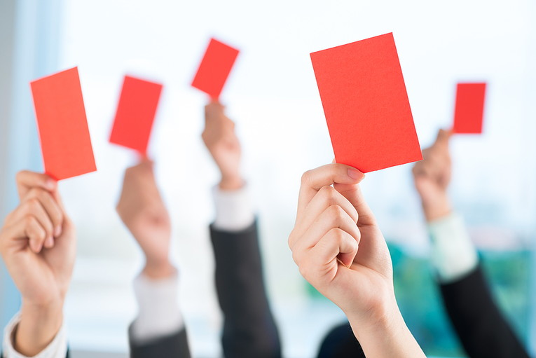 Business People Holding Up Red Cards