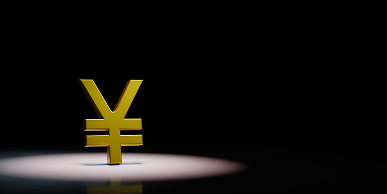 Gold Yen Symbol Under Spotlight