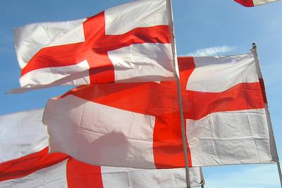 England Flags Against Blue Sky