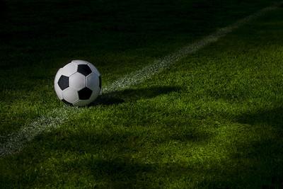 Football on Pitch in Dark