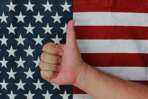 Thumb Up In Front of USA Flag