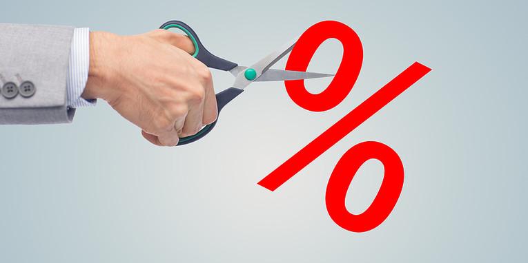 Businessman Cutting Percentage Symbol