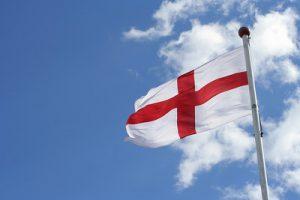 England Flag Against Blue Sky