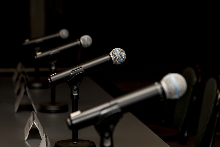 Row of Microphones in Conference Room