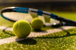 Tennis Racket on Grass Court