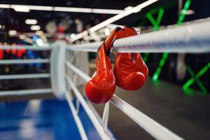Boxing Gloves Hanging on Gym Ring
