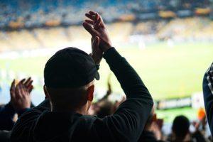 Football Fan Clapping Inside Stadium