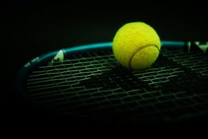 Tennis Racket Against Black Background