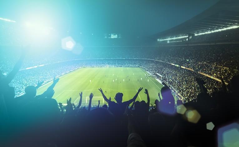Football Fans in Stadium During Night Match