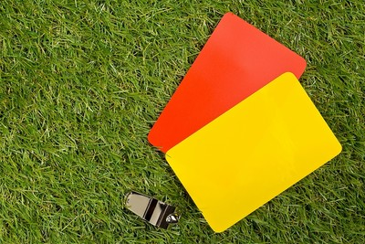 Referees Cards and Whistle on Grass