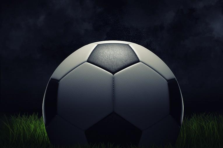 3D Football on Dark Background